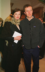 Model HONOR FRASER and her cousin MR NED FRASER, at a party in London on 23rd February 1999.MOO 131