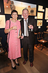 Sports commentator JOHN MOTSON and his wife ANNE at an auction and priavte view of paintings, drawings, stories and doodles by well known personalities held at Christie's, St.James's, London on 20th September 2010.