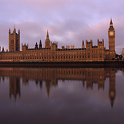 Houses of Parliament at sunrise, Big Ben and the Palace of Westminster, Westminster Bridge and Thames River, London, England, UK<br />
