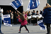 Young Tottenham fans with flags before the FA Women's Super League match between Tottenham Hotspur Women and Arsenal Women FC at Tottenham Hotspur Stadium, London, United Kingdom on 17 November 2019.
