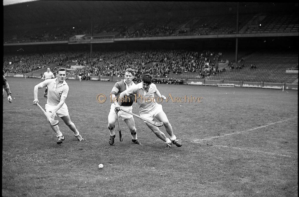 10/09/1967<br /> 09/10/1967<br /> 10 September 1967<br /> Under-21 Hurling Final: Dublin v Tipperary at Croke Park, Dublin.<br /> A Tipperary forward being tackled by two Dublin backs.