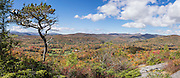 In mid October, enjoy vibrant fall foliage colors at Flat Rock Overlook on a 1.2-mile loop trail from Blue Ridge Parkway milepost 308.2 in Pisgah National Forest, North Carolina, USA. From Flat Rock Overlook, see Linville Valley and the Roan and Hump Mountains. This panorama was stitched from 3 overlapping photos from October 12, 2015.
