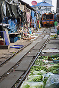 The Maeklong railway market is famous for the train that passes through six times a day. Vendors have to pull down shades over their stalls, and the produce is positioned in such a way that the train passes directly over it. In recent years it has become a key tourist stop.