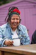 Drinking tea and chatting in the garden at Windswept rehabilitation unit, Sandalwood Court, Swindon.