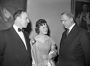 20/2/1959<br /> 02/20/1959<br /> 20 February 1959<br /> <br /> Mr Donal ÓMóráin of Gael Linn, President Éamon de Valera and an unamed woman speaking at Cunmann Gaelach Inaugural