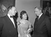 20/2/1959<br /> 02/20/1959<br /> 20 February 1959<br /> <br /> Mr Donal ÓMóráin of Gael Linn, President Éamon de Valera and an unamed woman speaking at Cunmann Gaelach Inaugural