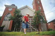 Tyce Buntin of the Master Gardeners maintains the lawn at The Belfry in Oxford, Miss. on Wednesday, July 14, 2010.