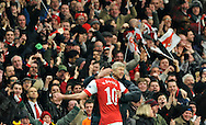 Arsenal's Robin Van Persie, left, celebrates with manager Arsene Wenger after scoring a goal against Barcelona during a Champions League, round of 16, first leg soccer match at Arsenal's Emirates stadium in London, Wednesday, Feb. 16, 2011.