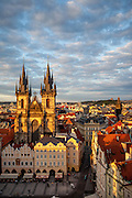 View to the Prague cityscape and the Tyn Church located at Old Town Square during sundown.