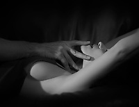 Artistic sensual couple black and white closeup of a beautiful woman face, man hands touching her lips