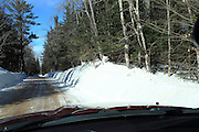 I'm not big on car photos, but I took this shot to capture the snow depth, which is significantly greater than the height of my truck. This is Rock River Road (also known as H01) in Alger County, just a bit north of Chatham, where the road heads into dense forest.