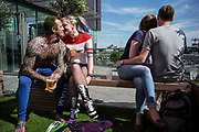 UNITED KINGDOM, London: 27-28 May 2017 Cosplay fans (left) share a moment at a bar outside of the MCM London Comic Con. <br /> The comic convention, which will be visited by tens of thousands of comic book and cosplay fans, is being held at London's ExCel this weekend. Rick Findler / Story Picture Agency