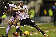 Derby County midfielder Bradley Johnson uses his strength in a challenge with Reading FC midfielder Garath McCleary during the Sky Bet Championship match between Derby County and Reading at the iPro Stadium, Derby, England on 12 January 2016. Photo by Aaron Lupton.