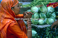 Woman selling fruit in Jaipur, India market