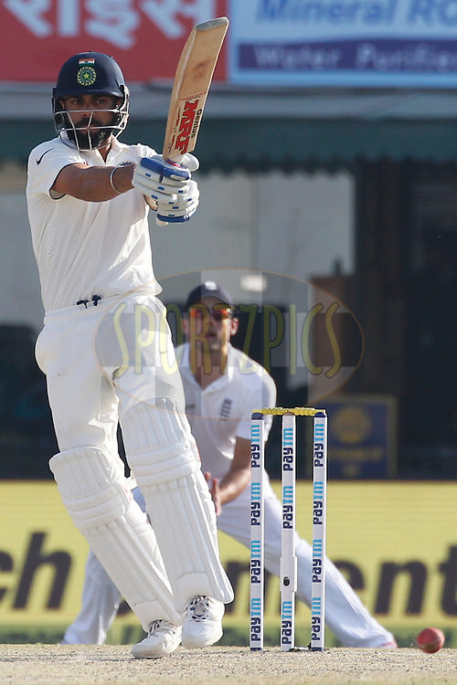 Virat Kohli Captain of India plays a shot during day 2 of the third test match between India and England held at the Punjab Cricket Association IS Bindra Stadium, Mohali on the 27th November 2016.<br /> <br /> Photo by: Deepak Malik/ BCCI/ SPORTZPICS