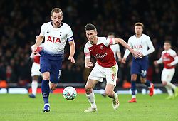 December 19, 2018 - London, England, United Kingdom - London, UK, 19 December, 2018.Laurent Koscielny of Arsenal  under pressure from Tottenham Hotspur's Harry Kane.during Carabao Cup Quarter - Final between Arsenal and Tottenham Hotspur  at Emirates stadium , London, England on 19 Dec 2018. (Credit Image: © Action Foto Sport/NurPhoto via ZUMA Press)
