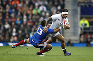 Picture by Andrew Tobin/Focus Images Ltd +44 7710 761829.23/02/2013. Manu Tuilagi of England is tackled by Mathieu Bastareud of France during the RBS 6 Nations match at Twickenham Stadium, Twickenham.
