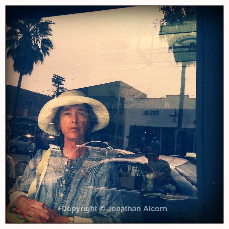 A woman waits at Gjelina to go on Abbot Kinney in Venice Beach