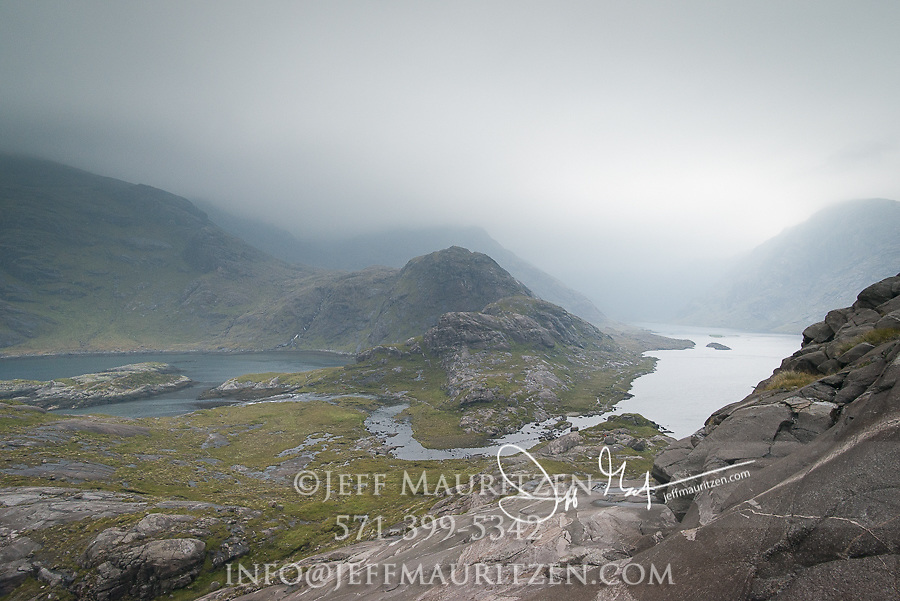 Loch Coruisk and the Scavaig River surrounded by the Black Cuillin mountains on the Isle of Skye, Scotland.