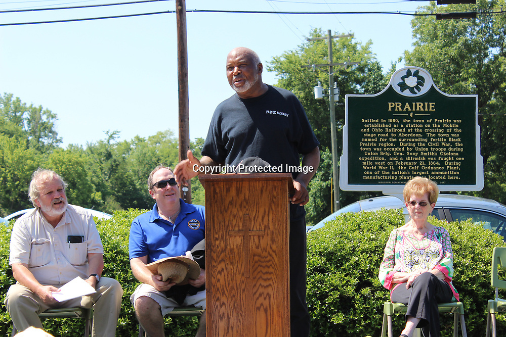 RAY VAN DUSEN/BUY AT PHOTOS.MONROECOUNTYJOURNAL.COM<br /> The Rev. Chester McNairy says a few words before giving the closing prayer during a historical marker presentation in Prairie. Also pictured are, from left, Mississippi Department of Archives and History representative Jack Elliot and Prairie residents, Eric Jonas and Faith West.