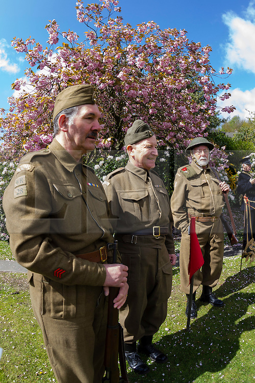 © Paul Thompson licensed to London News Pictures. 16/05/2015. Haworth, West Yorkshire, UK. Volunteers dressed as a Home Guard platoon at Haworth 1940s weekend, an annual event in which people dress in period costume and visit the village of Haworth to relive the 1940s. Photo credit : Paul Thompson/LNP