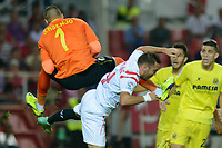 Villarreal goalkeeper J. Asenjo (L) and  Sevilla's Iago Aspas collide hard  during the match between Sevilla FC and Villarreal day 9 spanish  BBVA League 2014-2015 day 5, played at Sanchez Pizjuan stadium in Seville, Spain. (PHOTO: CARLOS BOUZA / BOUZA PRESS / ALTER PHOTOS)