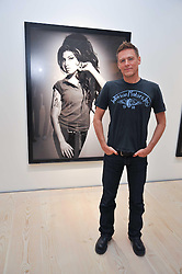 BRYAN ADAMS at an exhibition of photographic portraits by Bryan Adams entitled 'Hear The World' at The Saatchi Gallery, King's Road, London on 21st July 2009.