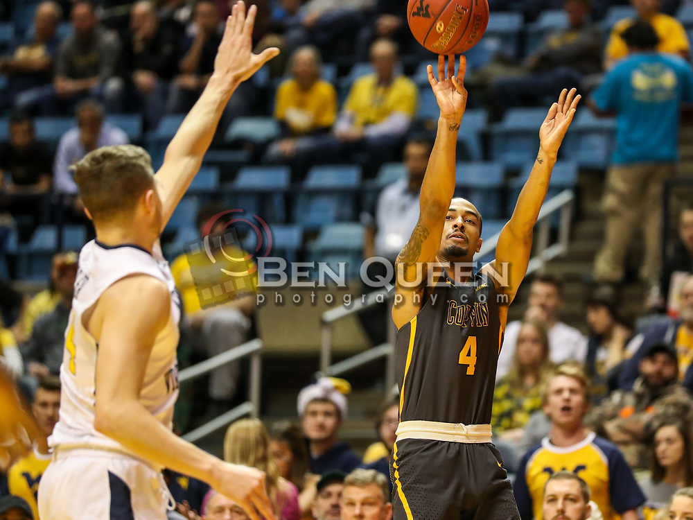 Dec 20, 2017; Morgantown, WV, USA; Coppin State Eagles guard Tre' Thomas (4) shoots a three pointer during the first quarter against the West Virginia Mountaineers at WVU Coliseum. Mandatory Credit: Ben Queen-USA TODAY Sports