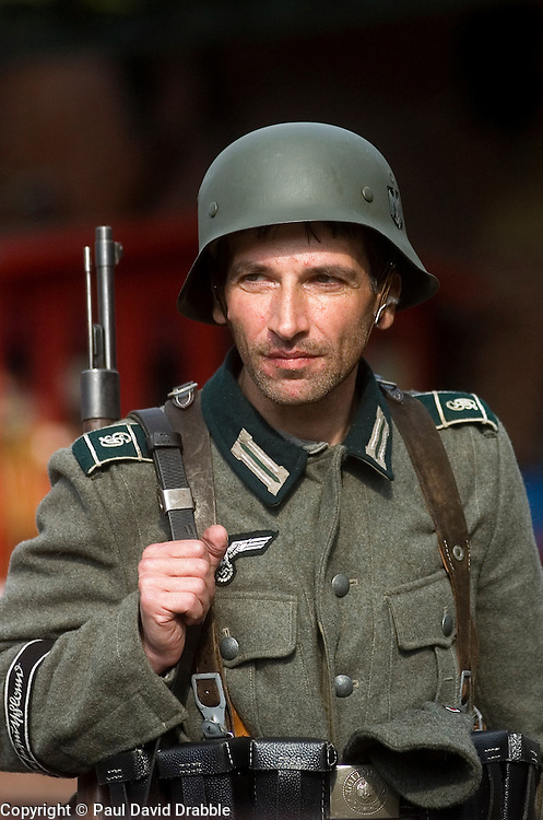 Living History Reenactor from the Northern World war Two Association Portrays a panzer grenadier of the German Gross Deutschland Division with bolt action mauser K98 Rifle, M36 uniform and Iconic Steel helmet, during the Elsecar 1940s wartime weekend event 2009