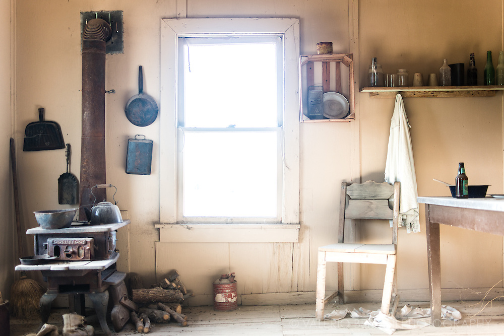 The remains of a kitchen, washed by desert light, inside an abandoned house in Shoeshone just outside the Death VAlley. Nevada, USA.