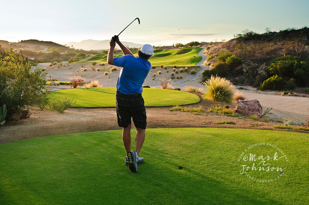 Golfer driving off tee, Palmilla Golf Course, San Jose del Cabo, Baja California Sur, Mexico
