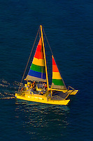 Aerial view of a catamaran cruising from Waikiki Beach, Honolulu, Oahu, Hawaii, USA