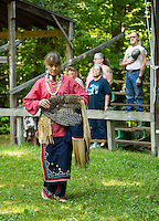 "Karen White ""One Feather"" dressed in traditional Northeast style dance during the Veteran's Song at the Laconia Indian Historical Association's Pow Wow on Sunday afternoon in Sanbornton.   (Karen Bobotas/for the Laconia Daily Sun)"