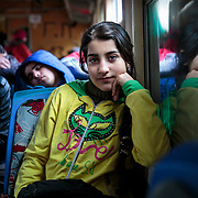 "Maram, 13, a refugee from Daraa, Syria, is about to depart by train with her family from Presevo, Serbia, to the Croatian border in January 2016. From there, they will continue on to Germany. ""The people in Greece were so nice to us, but the journey has been very exhausting, and the boats were very scary. Now we are going to Germany, and we will study and learn the language. And we will stay there and hope for a happy life."""