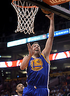 Apr 5, 2013; Phoenix, AZ, USA; Golden State Warriors forward David Lee (10) lays up the ball during the game against the Phoenix Suns in the first half at US Airways Center. Mandatory Credit: Jennifer Stewart-USA TODAY Sports