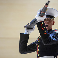 Tyler Nunes performs with the national champion rifle drill team from the Grants High School Marines Junior Officer Reserve Training Corps during an awards ceremony at Grants High School Wednesday.