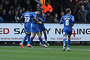 George Francomb of AFC Wimbledon and Paul Robinson of AFC Wimbledon celebrate Paul's goal during the Sky Bet League 2 match between Cambridge United and AFC Wimbledon at the R Costings Abbey Stadium, Cambridge, England on 2 January 2016. Photo by Stuart Butcher.