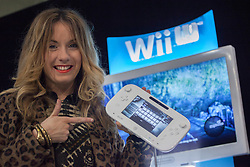 © licensed to London News Pictures. London, UK 29/11/2012. A new Nintendo Wii U owner posing at the launch of Nintendo's latest gaming console at HMV Store in Oxford Street, London. Photo credit: Tolga Akmen/LNP