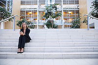 Businesswoman sitting on steps outside office
