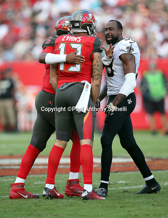 New Orleans Saints cornerback Brandon Browner (39) yells at Tampa Bay Buccaneers wide receiver Mike Evans (13) after an altercation that draws a fourth quarter personal foul penalty on Browner during the 2015 week 14 regular season NFL football game against the Tampa Bay Buccaneers on Sunday, Dec. 13, 2015 in Tampa, Fla. The Saints won the game 24-17. (©Paul Anthony Spinelli)