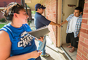 Chavez High School principal Rene Sanchez and Maria Jaramillo go door-to-door looking for potential dropout students during the Grads Within Reach program, September 6, 2014.