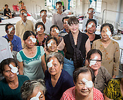 Gabi Hollows with the patients over one day of surgery Vinh Long Centre of Social Diseases Prevention.