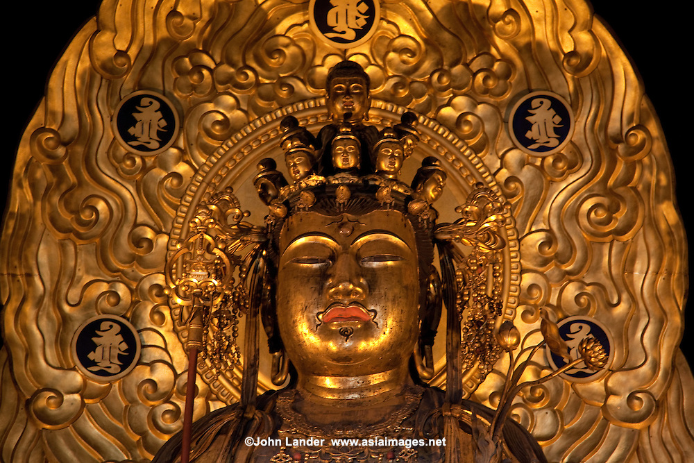 "The magnificent statue of Hase Kannon is housed here for all to see and worship. It is 9 meters pr 30 feet tall and has eleven heads in addition to its main one - three in front, three to the left and three to the right, plus one at the top and another on the back. Each face has a different expression, signifying that the deity listens to the wishes of all types of people. Gold leaf was applied to the statue in 1342 and in 1392 the halo was added. Although Kannon is usually described in English as ""the Buddhist Goddess of Mercy"" strictly speaking it is neither masculine nor feminine and represents compassion, mercy, and love."