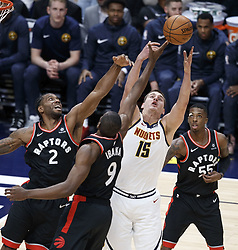 December 16, 2018 - Denver, Colorado, U.S - Nuggets NIKOLA JOKIC, right center, goes up for a rebound in traffic during the 2nd. Half at the Pepsi Center Sunday evening. The Nuggets beat the Raptors 95-86. (Credit Image: © Hector Acevedo/ZUMA Wire)