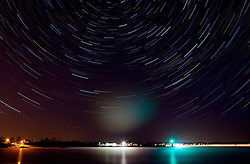 Star trails above the Coast Guard station in New Castle, New Hampshire.