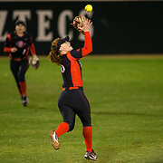 02 March 2018: San Diego State softball closes out day two of the San Diego Classic I at Aztec Softball Stadium with a night cap against CSU Northridge. San Diego State shortstop Shelby Thompson (20) makes a leaping catch on bloop hit into shallow left field in the fifth inning. The Aztecs dropped a close game 2-0 to the Matadors. <br /> More game action at sdsuaztecphotos.com