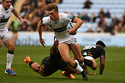London Irish wing Ollie Hassell-Collins (11) runs with the ball during the Gallagher Premiership Rugby match between Wasps and London Irish at the Ricoh Arena, Coventry, England on 20 October 2019.