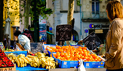 Shopping for fresh fruit at a farmer's market in the Place Carnot in Carcassonne in southern France<br /> <br /> (c) Andrew Wilson   Edinburgh Elite media