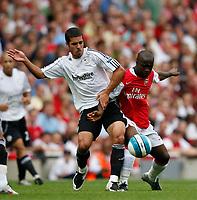 Photo: Steve Bond.<br />Arsenal v Derby County. The FA Barclays Premiership. 22/09/2007.Benny Feilhaber (L)and  Lassana Diawara (R) tangle