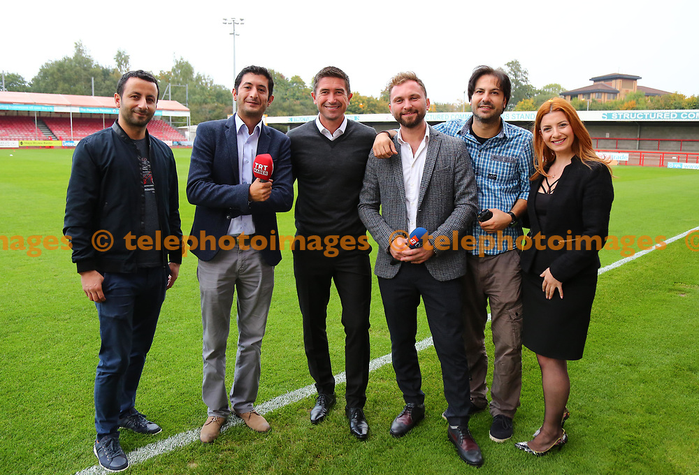 Crawley Town's head coach Harry Kewell and Turkish TV crew during the Sky Bet League 2 match between Crawley Town and Newport County at the Checkatrade Stadium in Crawley. 26 Sep 2017